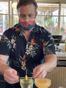 Mixologist Justin Gordon Adding Garnish on Cocktails