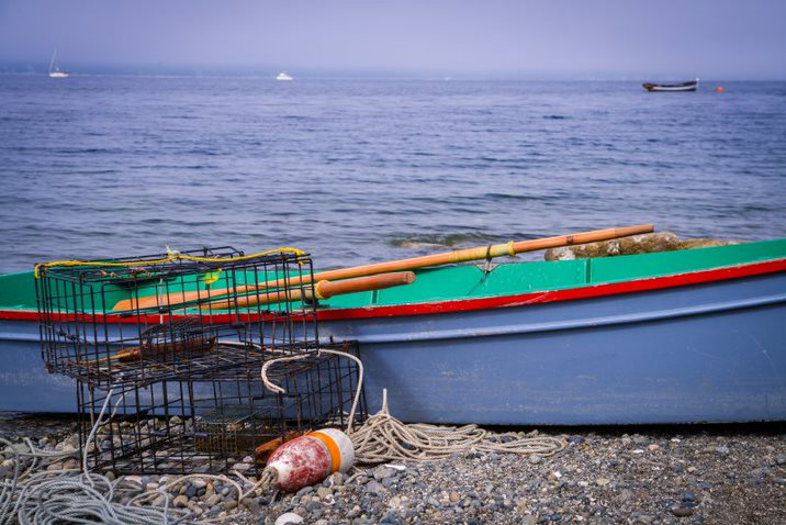 Crab Rings and Boat on Shore - Photo by Vision Photography