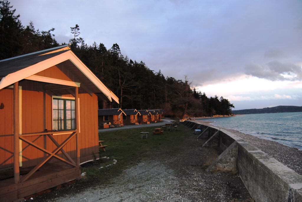 Cama Beach Cabins on Water Frontage by Sherrye Wyatt