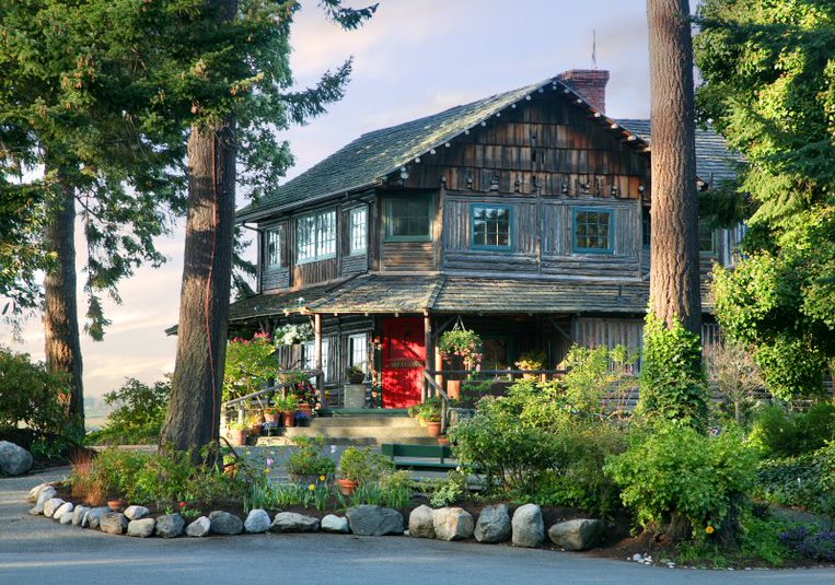 Captain Whidbey Inn in Forested Area by Sherrye Wyatt