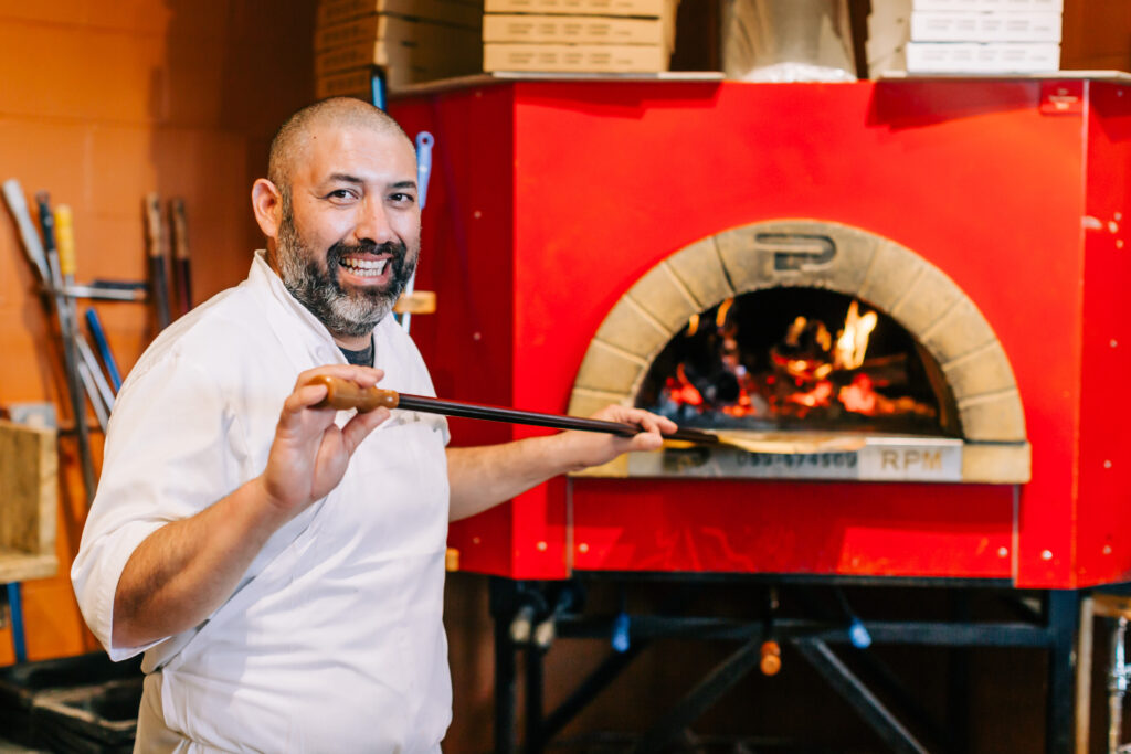 Chef with Wooden Pizza Oven at Ciao Restaurant