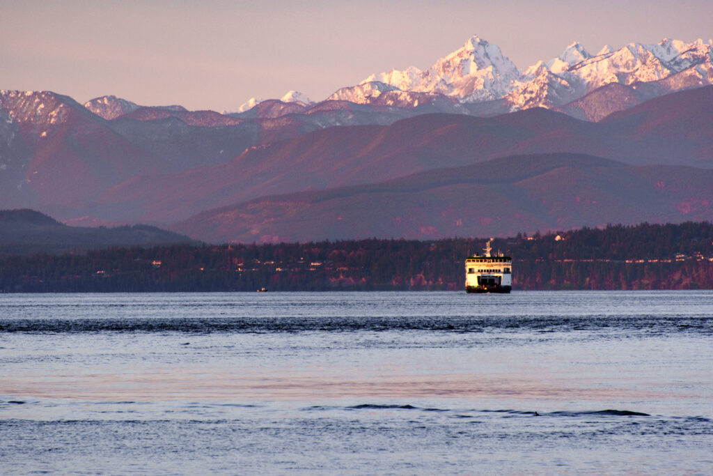 Washington Ferry Headed to the Islands with Mountains in the Background