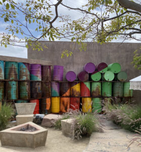 Colorfully Painted Barrels Forming a Fountain