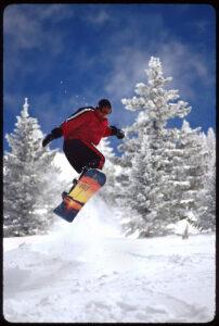 Snowboarder Midair by Jay Blackwood