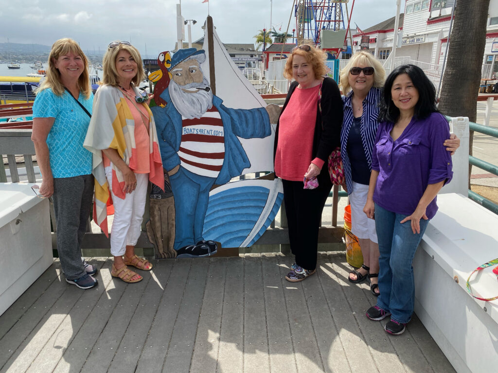 Duffy Boat Ceramic Captain with 5 Women Around Him Waiting to Board