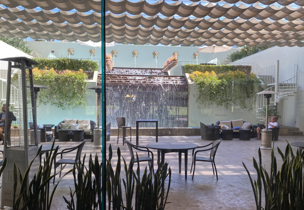 View of patio area with Neptune waterfall spouts inside the Westin South Coast Plaza