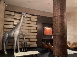 Two Giraffe Sculptures by front door
